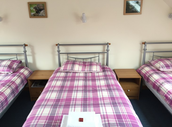 Room 4 has four single beds.